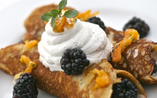 Plantain crepes topped with yogurt and berries